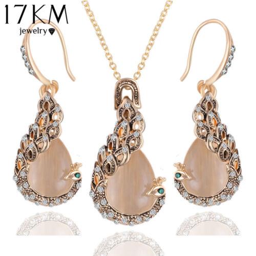 Pfau Schmuck Set - Ohrringe, Anhänger, Kette. Gold mit Strass und beige Opal