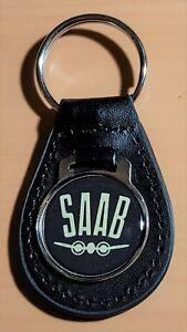 Saab-Schluesselanhaenger-auf-Leder-Masse-Emblem-29mm