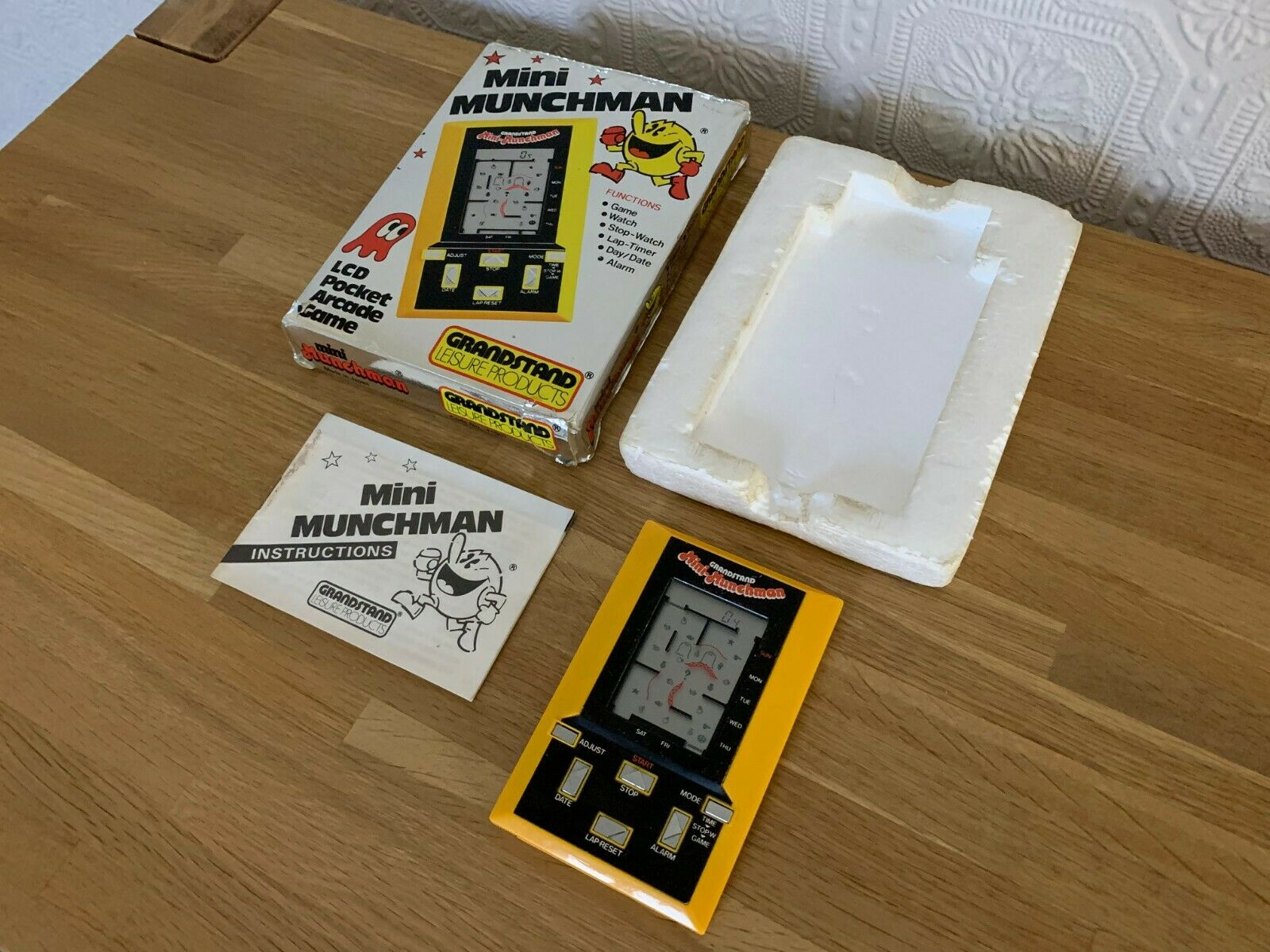 Boxed 1981 Vintage Grandstand Mini Munchman LCD Handheld Electronic Game in VGC.