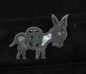Vintage donkey brooch matchless message