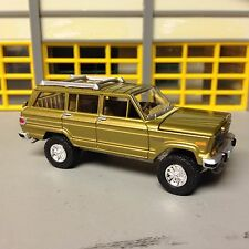 """1/64 1981 Jeep Wagoneer 4X4 in Gold with a 4"""" lift Kit riding on 30"""" rubber tire"""