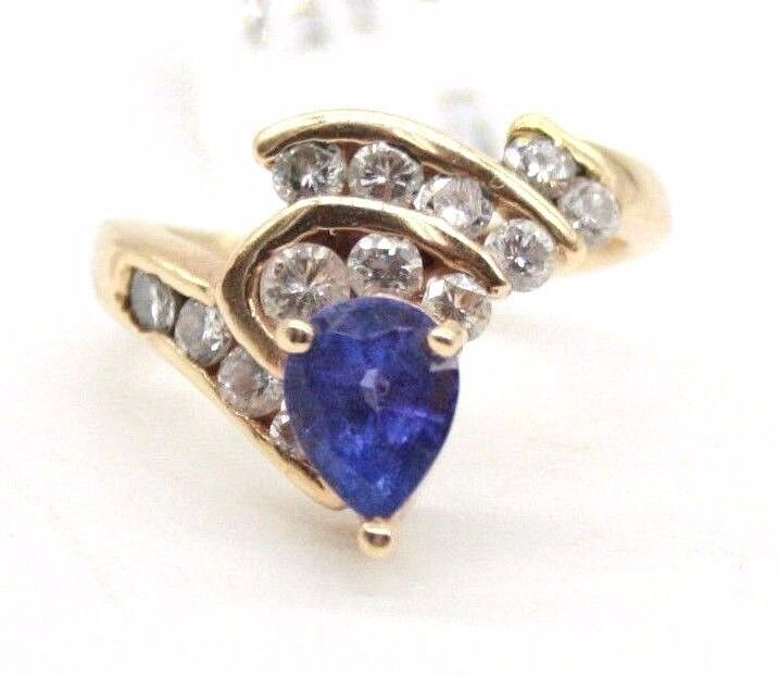 LADIES 14K YELLOW gold ESTATE RING WITH TANZANITE & DIAMONDS.SIZE 4