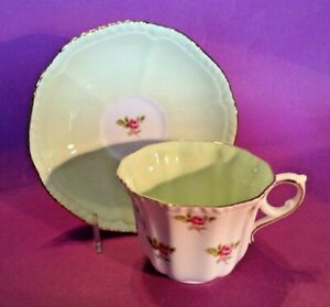Royal-Grafton-Teacup-And-Saucer-Pale-Green-Interiors-With-Pink-Roses-England