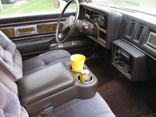 Midnight Black Seat Console With Flip Up Armrest and Cup Holders
