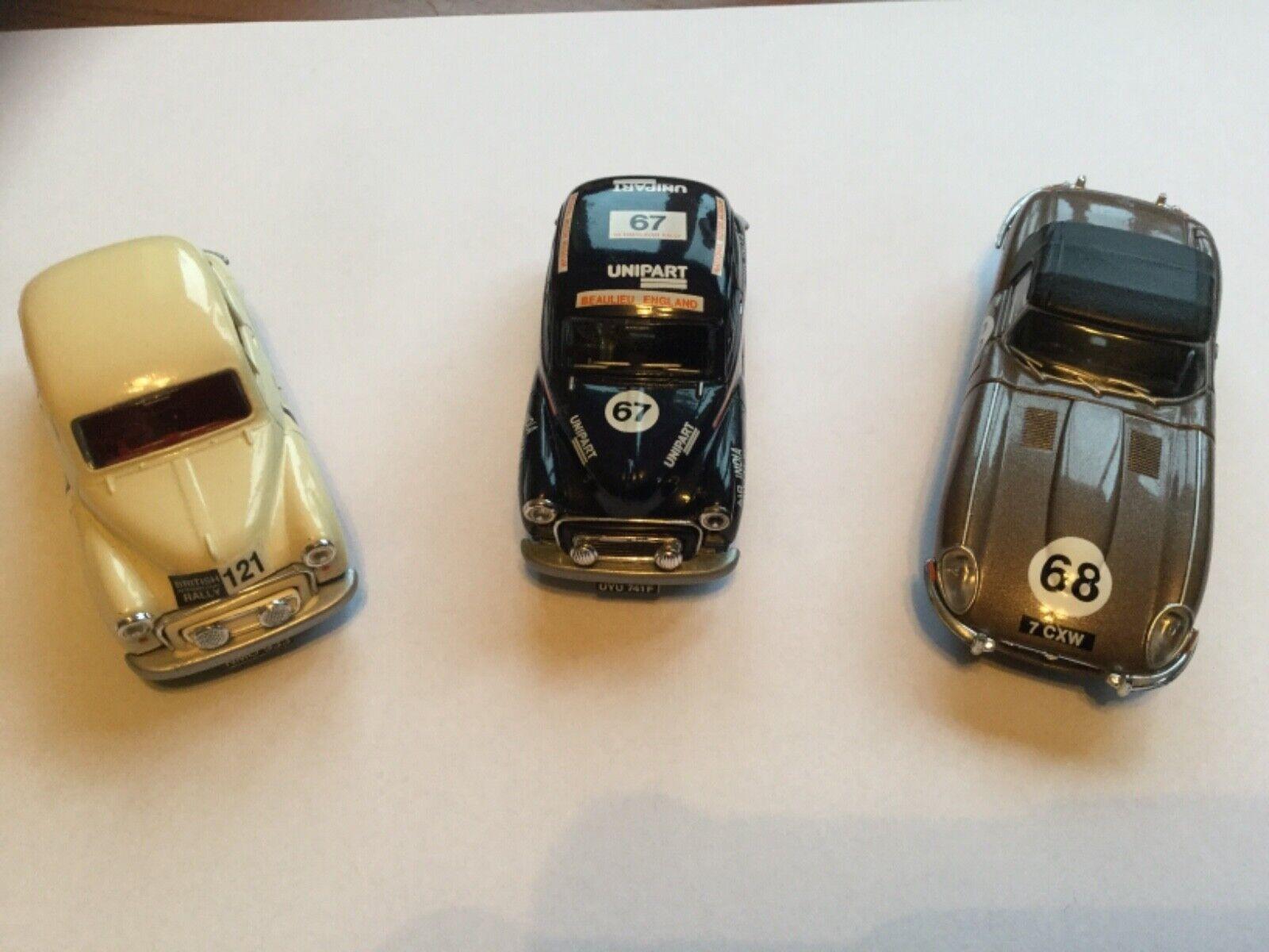3  Corgi  Rally cars  2 x Morris Minors and an E Type Jag