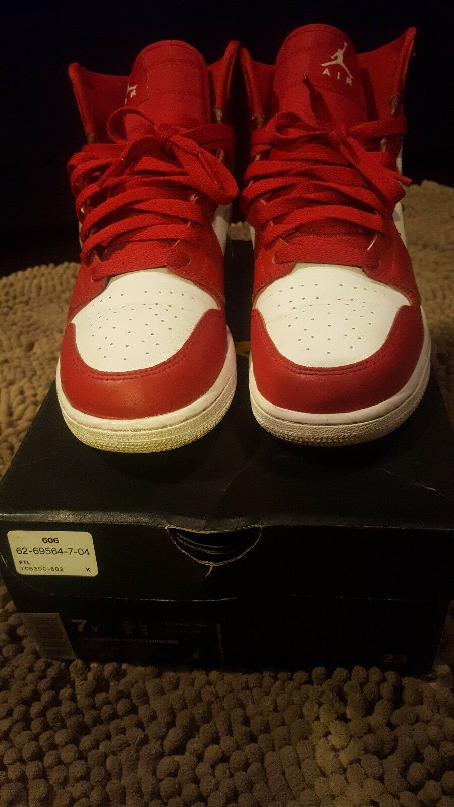 Gym Red 1s. These are Jordan Hightop 1s