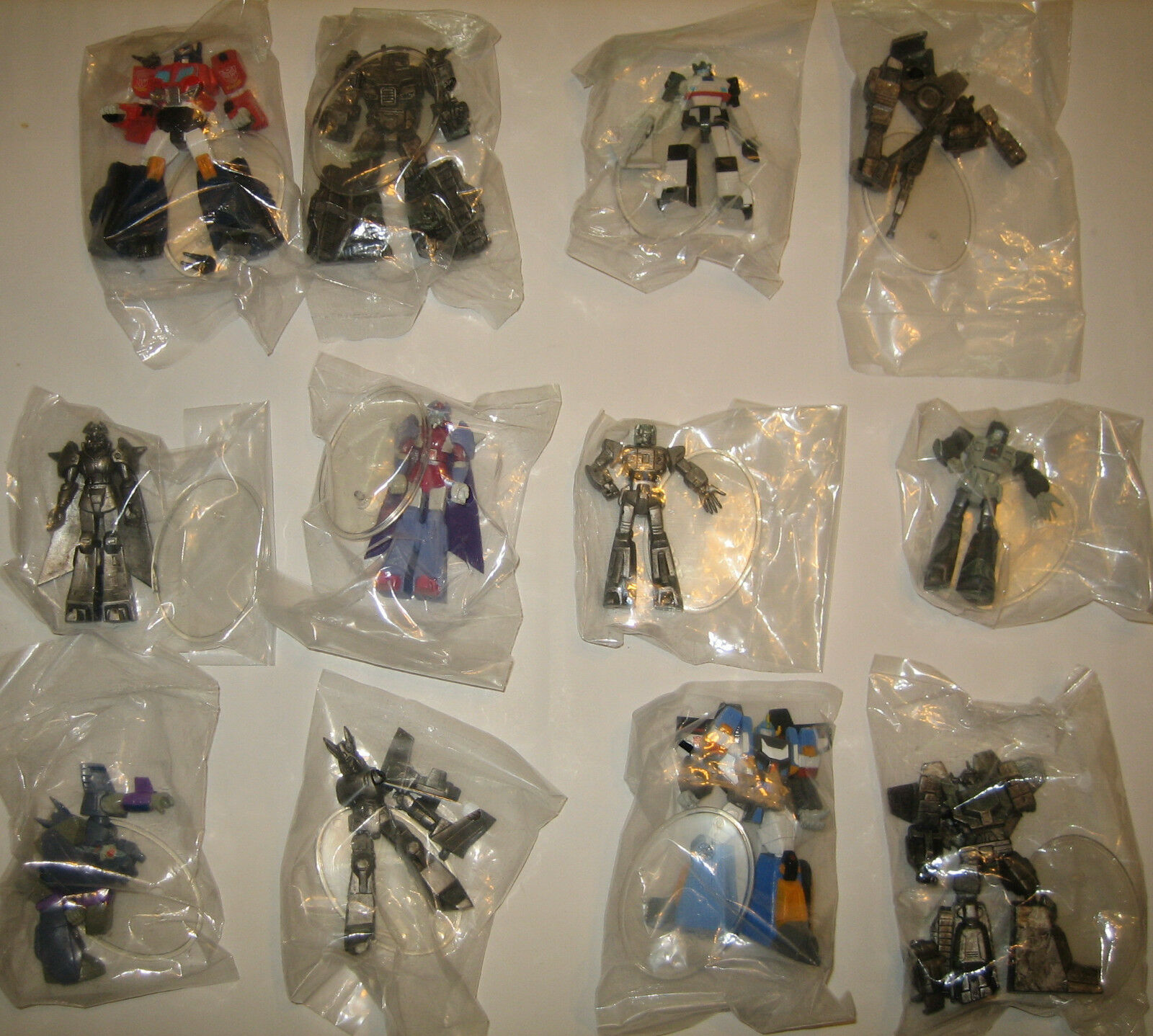 Transformers ACT 8 - - - 12 Figure Set - color & Grey Variants - Jazz Optimus 7288b4
