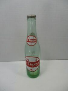 4 old 10 2 dr pepper bottles Trying to