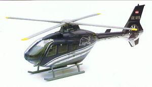 Eurocopter-EC135-Red-Bull-1-100-NewRay-Hubschrauber-Fertigmodell