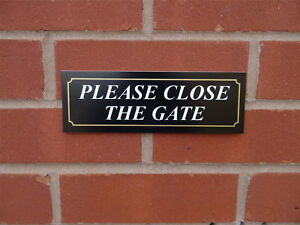 All Materials white and gold Black Please shut the gates sign
