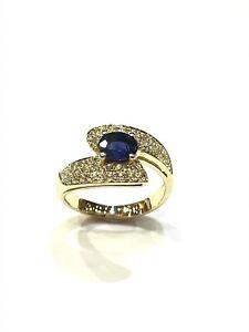 Bague-croisee-en-or-18-carats-diamants-et-saphir