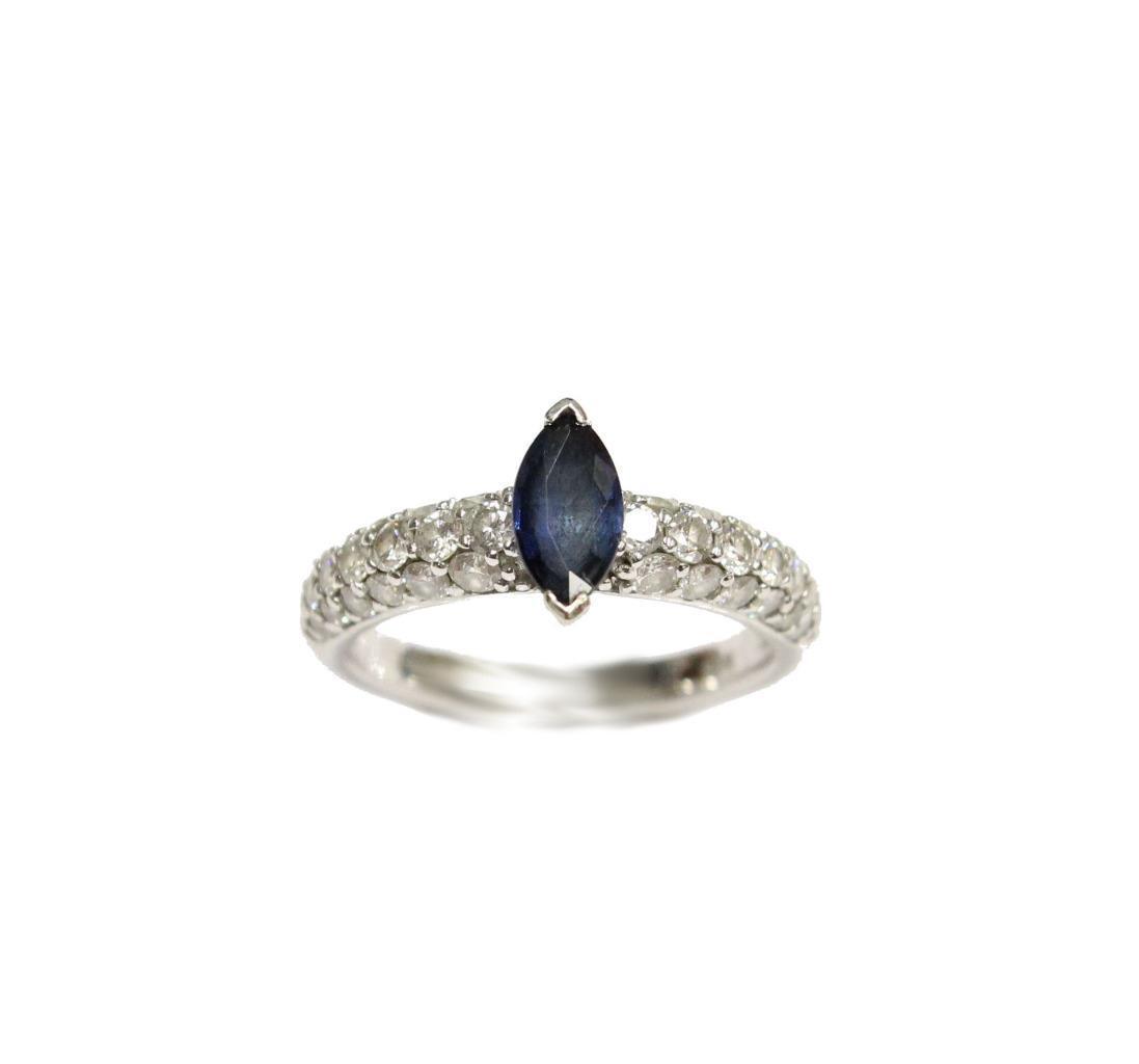 18 Karat White gold .60 Carat bluee Sapphire and Diamond Ring Type II VS Size 5.5
