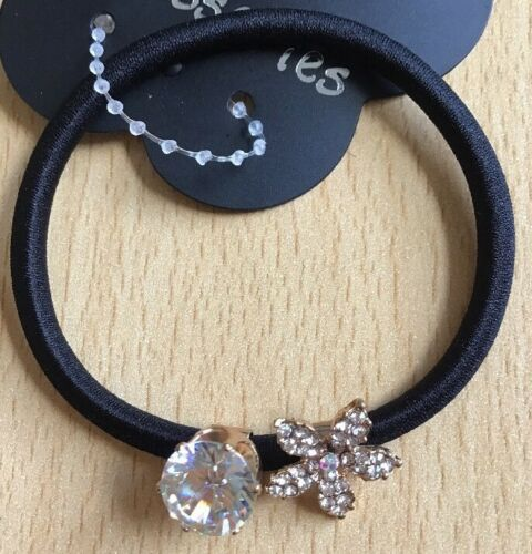 A Beautiful Diamanté And Encrusted Flower Embellished Hair Bobble
