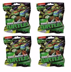 Lot-of-4-Teenage-Mutant-Ninja-Turtles-Keychain-Figurines-Series-1-Blind-Pack