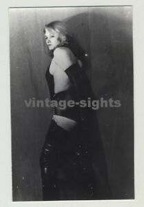 Side-View-Of-Appealing-Female-Stripper-In-Lacquer-Outift-Vintage-Photo-1960s