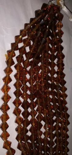 8mm Amber Colored Bicone Crystal 10 Strands 27 Beads Per Strand 270 Beads