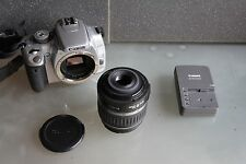 Canon EOS 400D 10.1MP Digital SLR Camera + Lens Bundle
