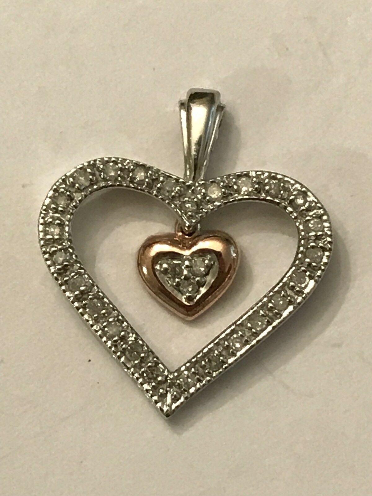 10k White and pink gold .12 Ct Tw Diamond Heart Pendant 1.4 Grams