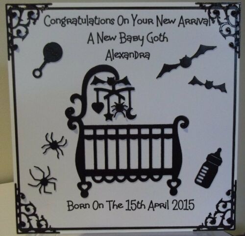 Handmade gothic personalised new baby card with a black cot and mobile design