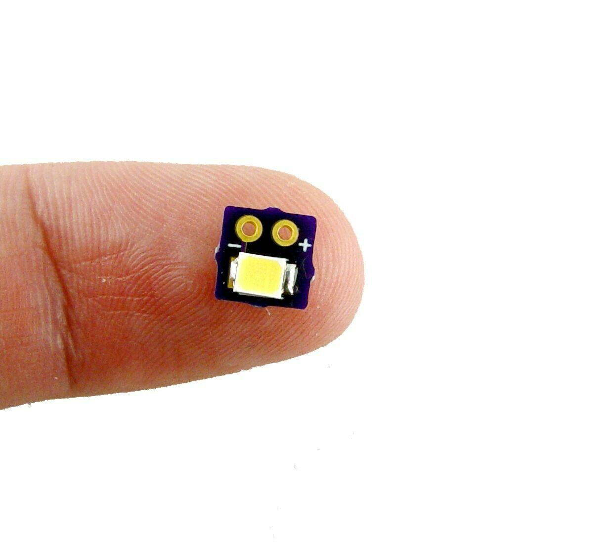 world smallest Nano Joule Thief with SMD cool white Led flashlight, startup 0.9V