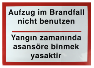 """türkisch Schild Aufkleber /""""Aufzug im Brandfall nicht benutzen/"""" zweisprachig dt."""