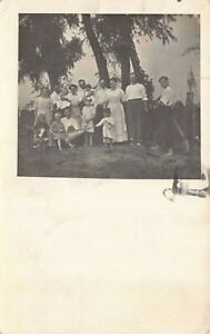 Real-Photo-Postcard-Family-Outdoors-Holding-Pennant-South-Bend-Indiana-125773