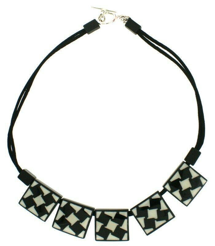 ZSISKA RESIN HOUNDSTOOTH NECKLACE WITH 5 SQUARE BEADS IN BLACK AND WHITE ON CORD WITH TOGGLE.