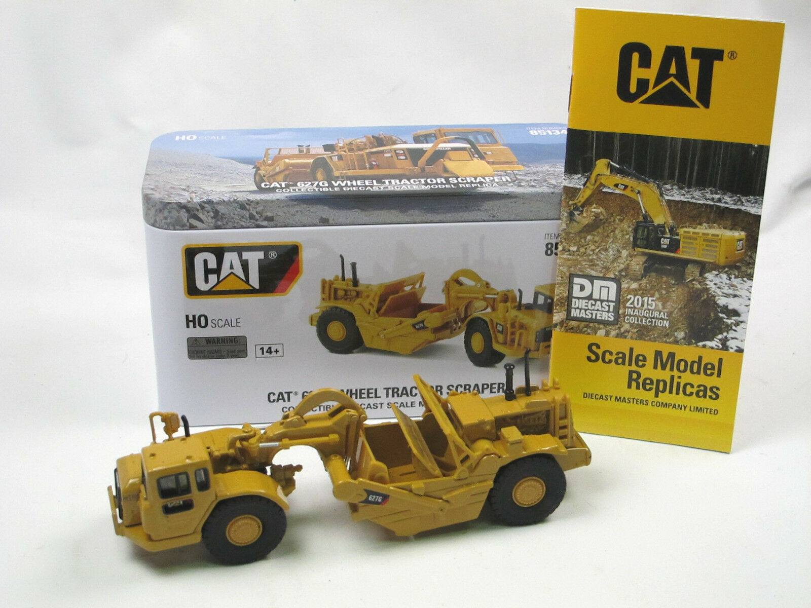 Diecast Masters 85134 CAT 627G Wheel Tractor Scraper Schürfzug H0 1 87 neu  | Billig ideal