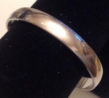 bracelet vintage couleur argent poli rigide top qualité signé Monet 374