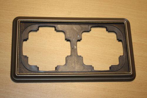 Gira Trias GALA 2-fach Rahmen braun metallic mit broncierter Zierkante