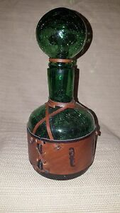 Awesome vintage dark green crackle glass decanter wih leather wrap