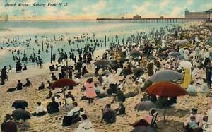 1912-VINTAGE-BEACH-SCENE-ASBURY-PARK-NJ-POSTCARD-CROWD-of-SWIMMERS-on-BEACH