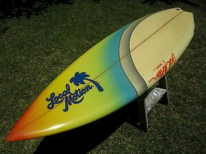 Vintage-1980s-era-Local-Motion-Surfboard-with-a-lot-of-coloring