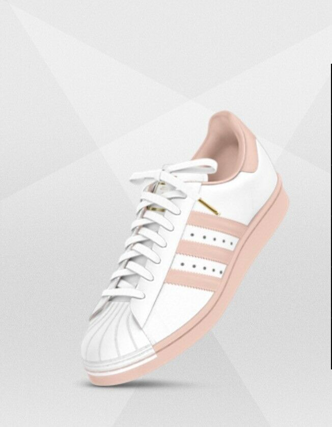 Pink and White Adidas Superstars with gold Laces