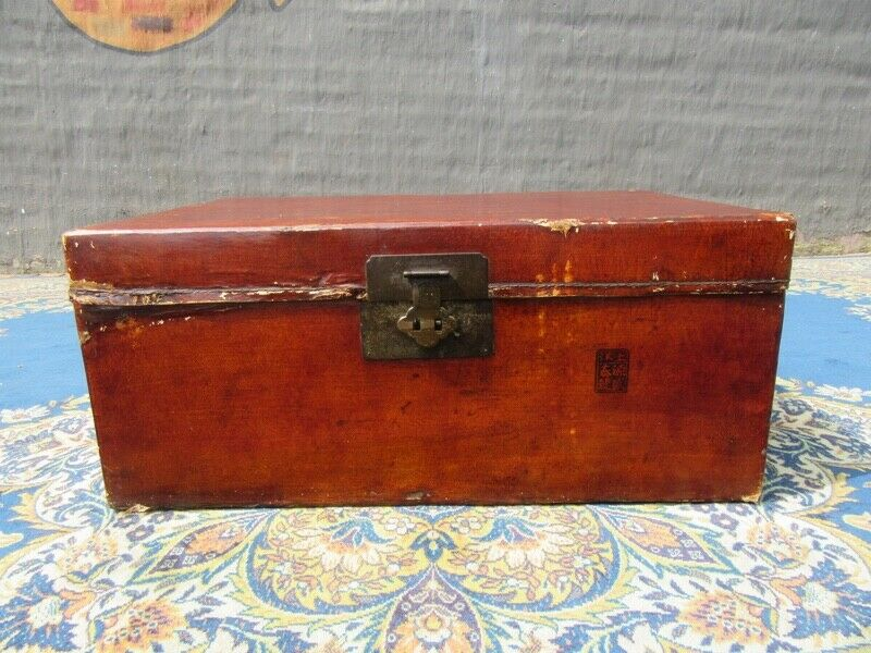 A nicely worn parchment leather trunk