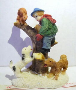 Squirrel Up A Tree with a Boy and His Dogs Decoration Figurine
