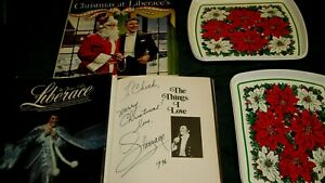 "LIBERACE OWNED ESTATE CHRISTMAS TRAYS & ALBUM & SIGNED BOOK, ""MERRY CHRISTMAS"""
