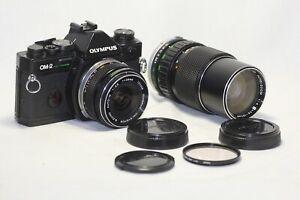 Olympus OM-2 Spot Program Film Camera G.Zuiko Auto-W 28mm F3.5 75-150mm F4 Lens