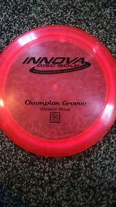 Innova-Champion-Groove-OOP-Stamp-Pinkish-red-167-gram-golf-disc