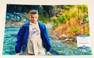 MILLIE-BOBBY-BROWN-034-11-034-SIGNED-11X17-METALLIC-PHOTO-STRANGER-THINGS-BAS-COA-964