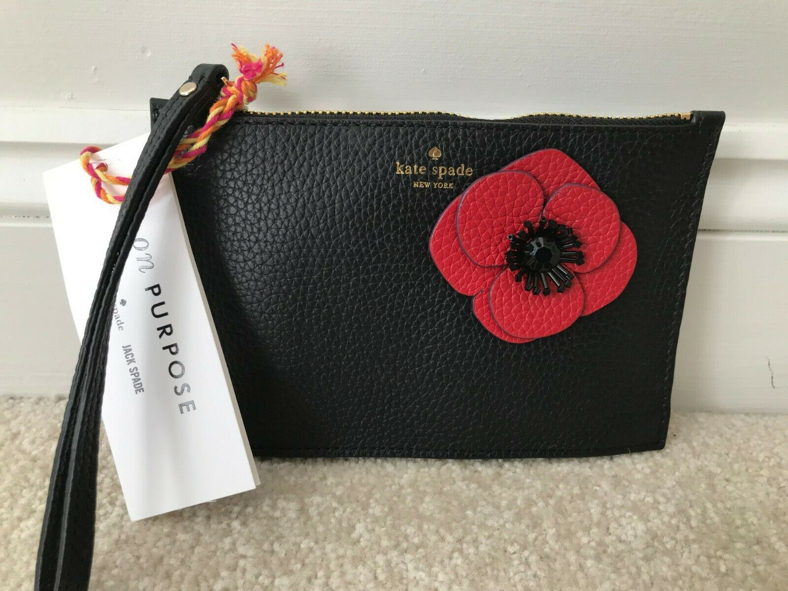 Kate spade on purpose applique red flower black pebble leather