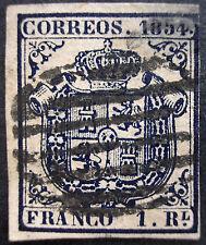 ESPAÑA 1854. Escudo de España. 1 real azul oscuro. Usado. Edifil 34 - 485 euros.