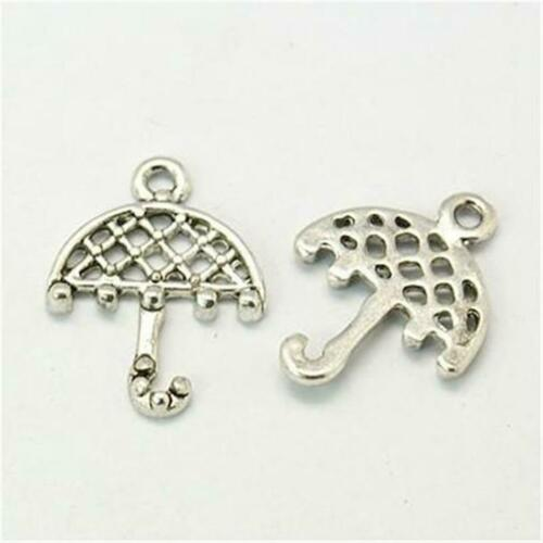 C242...A PACK OF 20 ANTIQUED SILVER PLATED UMBRELLA CHARMS