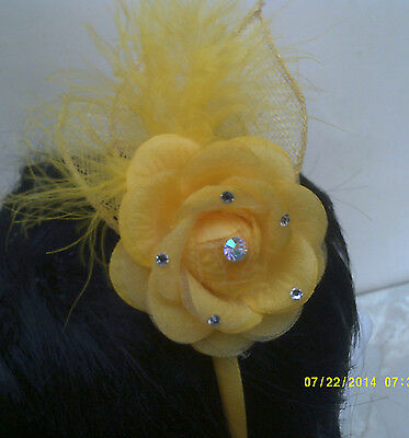 FASCINATOR  flower and netting and feathers on a covered headband col yellow
