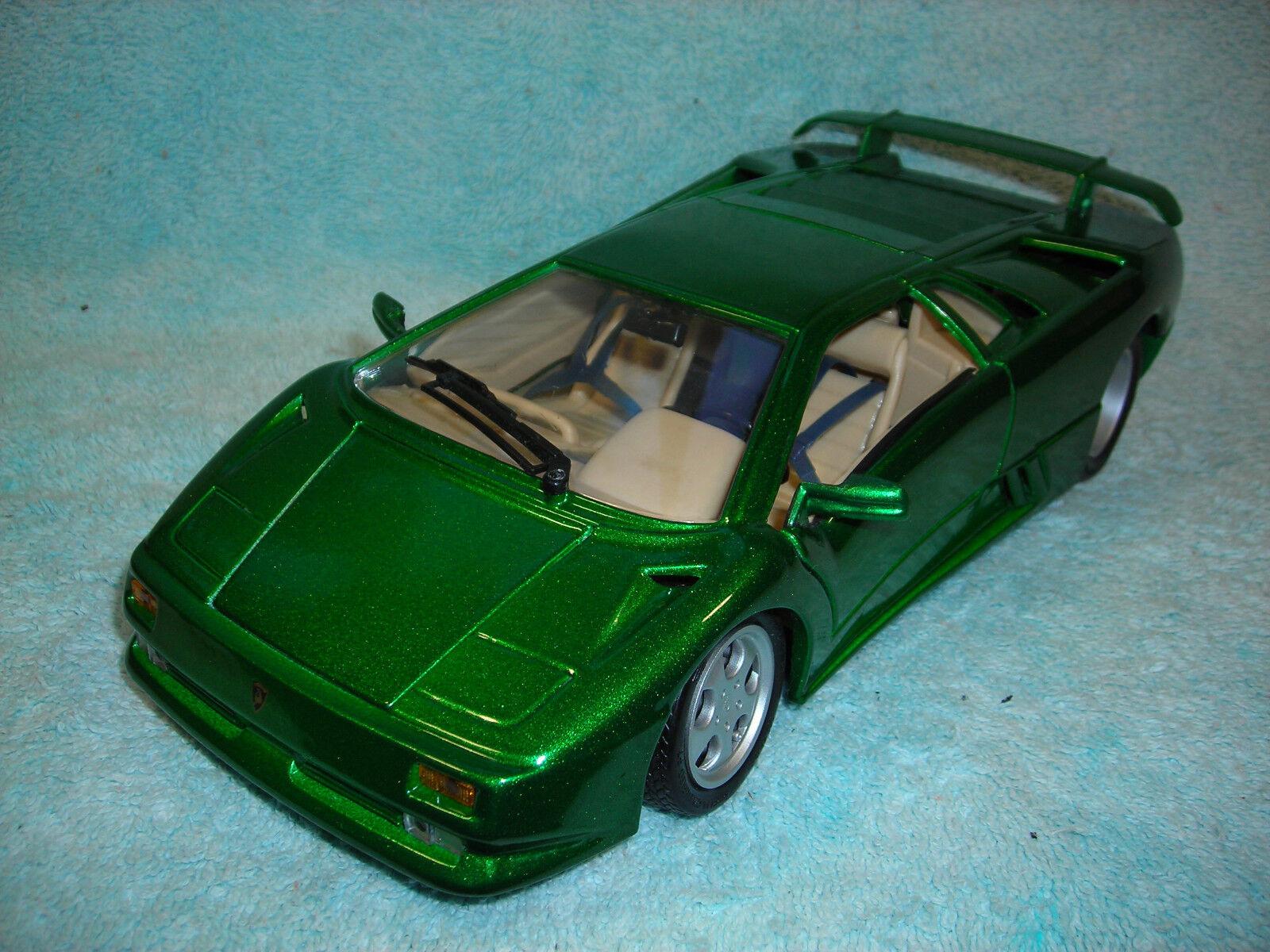 1 18 SCALE DIECAST 1994 LAMBOGHINI SE IN METALLIC GREEN  BY MAISTO NO BOX.