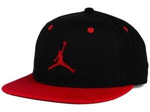 585ab5fc7d82 NEW YOUTH JORDAN NIKE HAT RED BLACK CAP JUMPMAN SNAP BACK 9A1535-391 ...