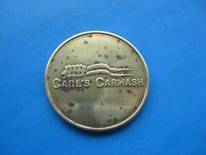 (K) CARL'S  CAR WASH GOLD COLOUR TOKEN COIN