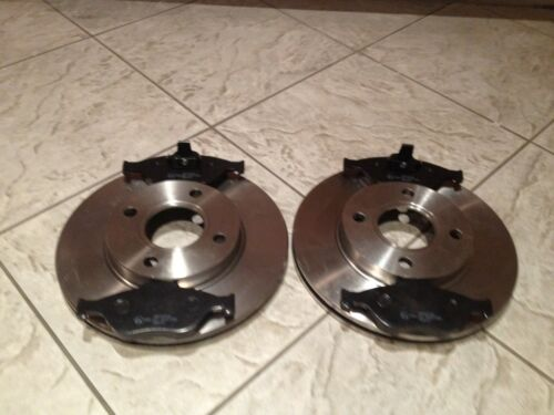 FORD KA   00-07  TWO FRONT VENTED BRAKE DISCS AND A SET OF BRAKE PADS