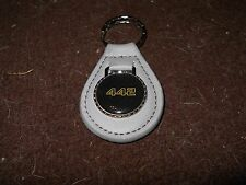 OLDSMOBILE 442 4-4-2 GOLD BLACK LOGO 1986 1987 1970's KEYCHAIN KEYRING GREY GRAY