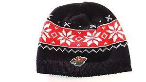 de694f1f9b6 MINNESOTA WILD Cuffless Knit Beanie Hat Women s Black SnowFlake ...